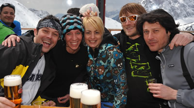 Apres ski party with friends on your slopeside deck.